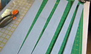 2 folded binding strips, 2 pre-fold
