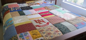 Finished quilt on bed