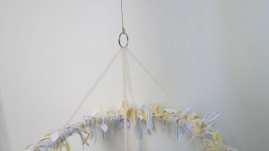 Twine attached to ring for hanging