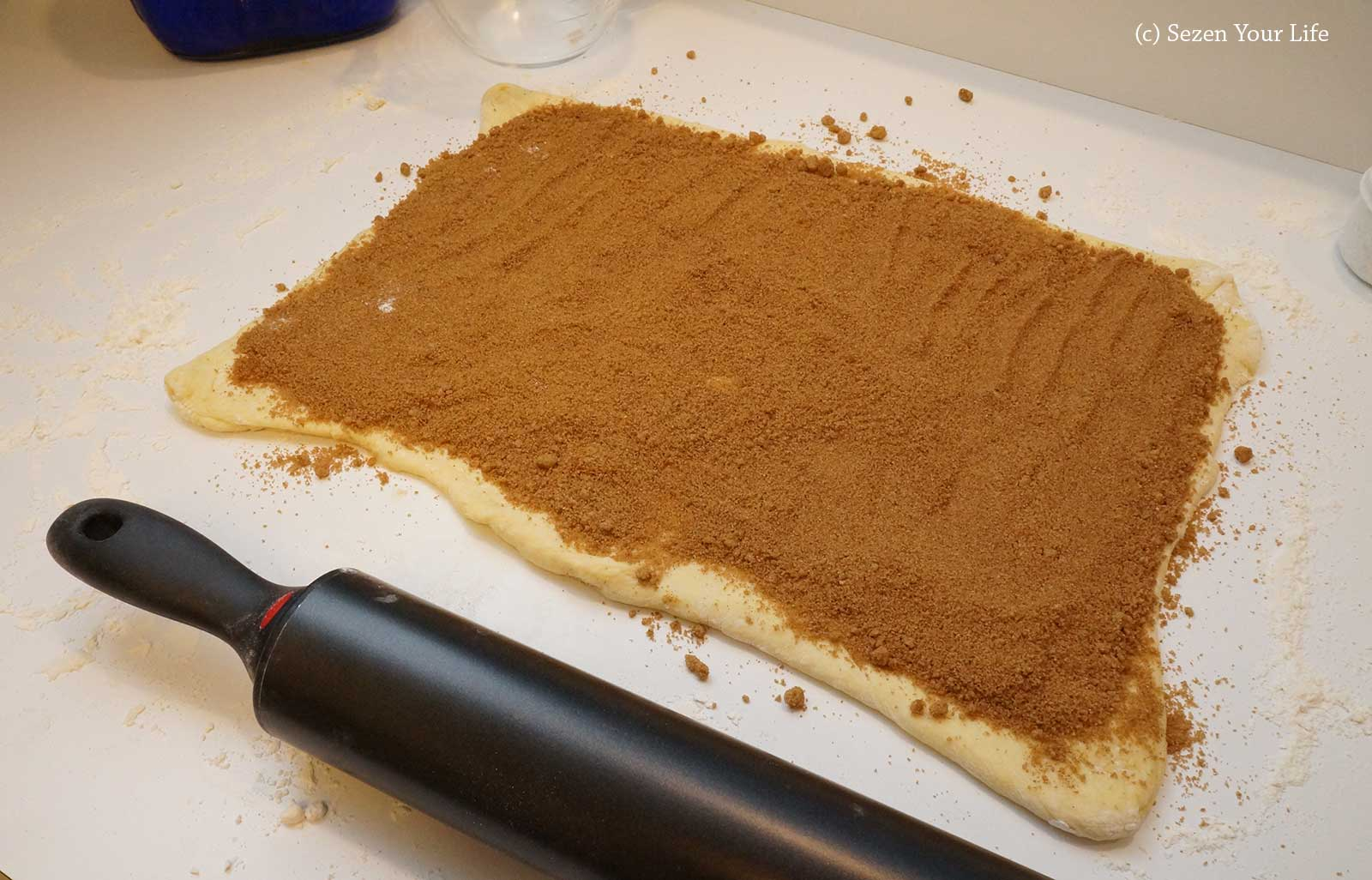 Sugar and Spice on dough for Cinnamon Rolls by Sarah Franzen